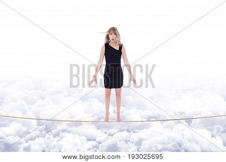 Girl Swings On Rope Stretched Out In The Sky Over The Clouds