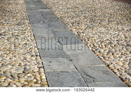 Perspective View of Gray Brick Stone on The Ground for Street Road. Sidewalk, Driveway, Pavers, Pavement in Vintage Design Flooring Square Pattern Texture Background