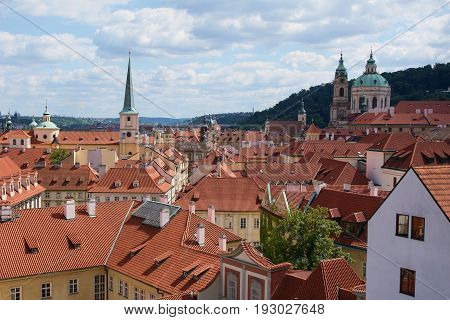 Beautiful panorama of the Lesser Town roofs view from one of the palace gardens under the Prague Castle Czech Republic