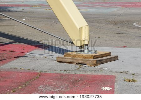 Extended side truck outrigger stabilizer. Support to mobile telescopic crane