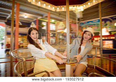 Asian Chinese Students Going To The Amusement Park