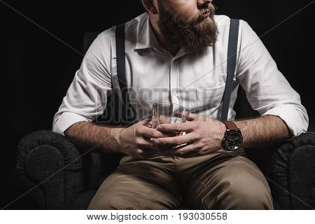 Cropped View Of Stylish Man In White Shirt And Suspenders Holding Whisky Glass Isolated On Black