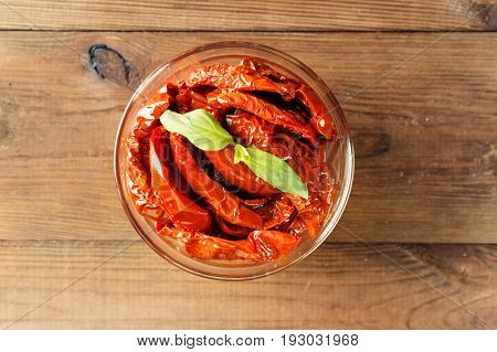 Italian Appetizer - Sundried Tomato In Bowl On The Wooden Table. Top View