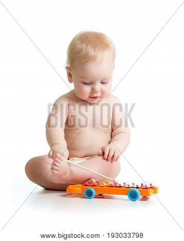 cute baby boy playing xylophone musical instrument isolated on a white background