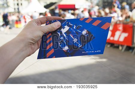 LE MANS, FRANCE - JUNE 16, 2017: Parade of pilots racing in downtown of Le mans, France. Postcard of new Alpine racing car A470