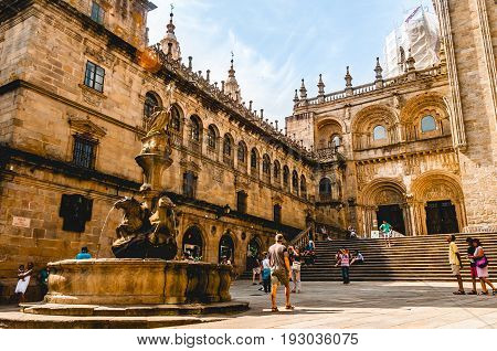 SANTIAGO DE COMPOSTELA, SPAIN - JULY 21, 2017. Tourists visiting and taking pictures of the Santiago de Compostela's Cathedral in its southern part in