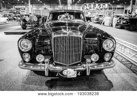 MAASTRICHT NETHERLANDS - JANUARY 14 2016: High-performance luxury car Bentley Continental S2 Drophead Coupe by Park Ward 1963. Black and white. International Exhibition InterClassics & Topmobiel 2016