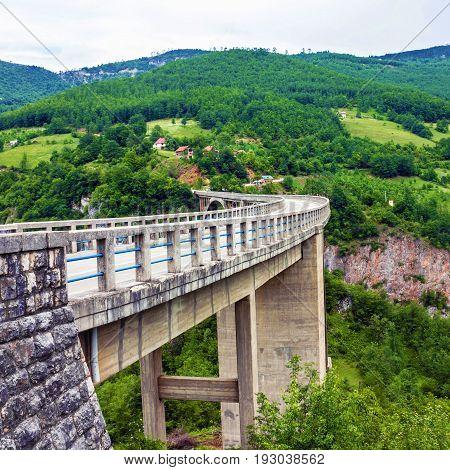 Mountain landscape Montenegro. Durdevica Tara arc bridge in the mountains