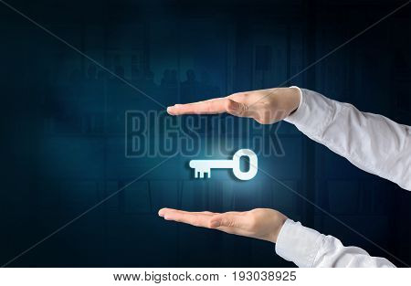 Key to success and business solution concept. Protecting gesture of businessman and symbol of a key and business background.