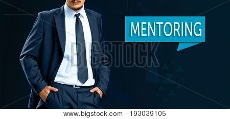 Coaching and human development concept. leader (businessMan manager) stands next to the banner with text MENTORING.