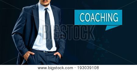 Coaching and human development concept. leader (businessMan manager) stands next to the banner with text COACHING.