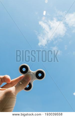 Hands Holding Fidget Spinner Toy