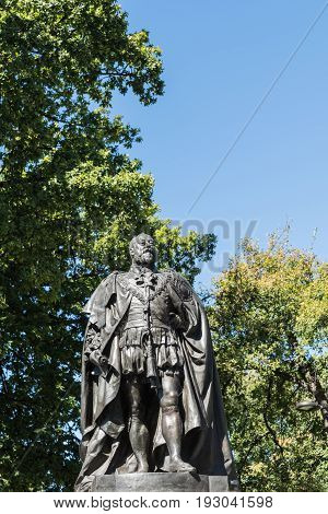 Hobart Australia - March 19. 2017: Tasmania. Closeup of bronze statue of King Edward VII shows him looking proudly and defiant. Green park background and blue sky.