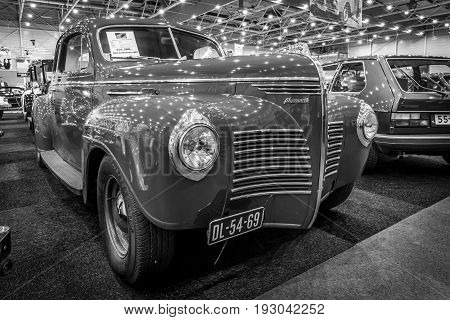 MAASTRICHT NETHERLANDS - JANUARY 15 2016: Full-size car Plymouth Deluxe (P10) Business Coupe 1941. Black and white. International Exhibition InterClassics & Topmobiel 2016