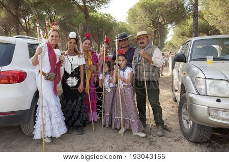 El Rocio Spain - June 1 2017: Group of pilgrims in traditional spanish dress on the road to El Rocio during the Romeria 2017. Andalusia Spain