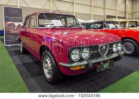 MAASTRICHT NETHERLANDS - JANUARY 15 2016: Compact executive car Alfa Romeo Giulia Nuova Super 1300 1975. International Exhibition InterClassics & Topmobiel 2016