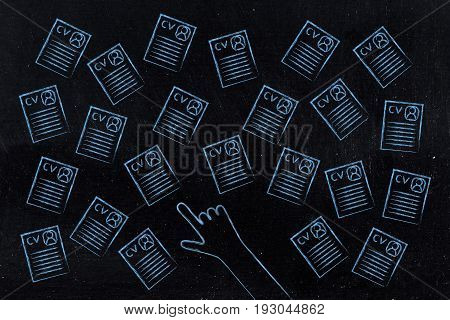 Hand Pointing At One Resume Among A Group Of Many
