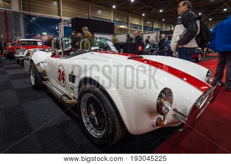 MAASTRICHT NETHERLANDS - JANUARY 15 2016: Sports car AC Cobra 427 S/C Pilgrim 1980. International Exhibition InterClassics & Topmobiel 2016