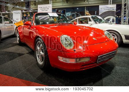MAASTRICHT NETHERLANDS - JANUARY 15 2016: Sports car Porsche 911 Carrera (993) Cabriolet 1995. International Exhibition InterClassics & Topmobiel 2016