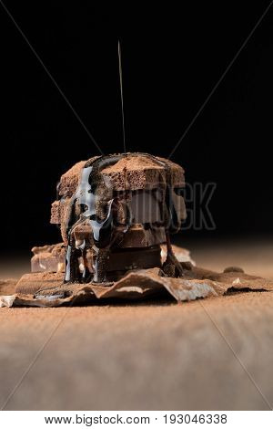 Porous chocolate sprinkled with syrup