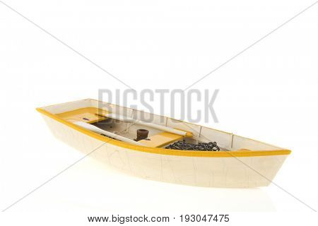 Wooden yellow row boat isolated over white background