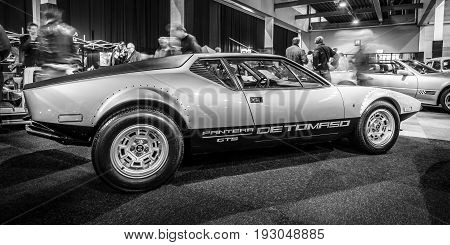 MAASTRICHT NETHERLANDS - JANUARY 15 2016: Sports car De Tomaso Pantera GTS 1973. Black and white. International Exhibition InterClassics & Topmobiel 2016