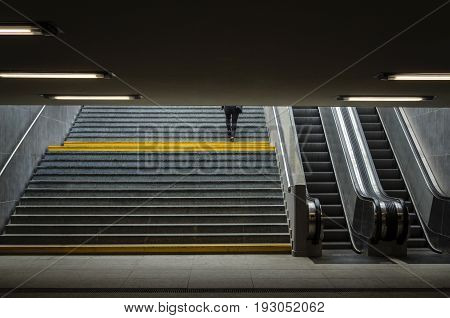UNDERPASS -Woman going up the stairs from the underground passage
