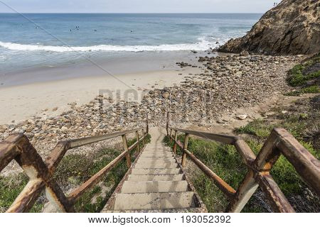 Rusty beach stairs at Dume Cove in Malibu, California.