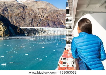 Travel tourist on cruise ship in Glacier Bay, Alaska, USA. Amazing view of glacier landscape on clear blue sky day in summer.