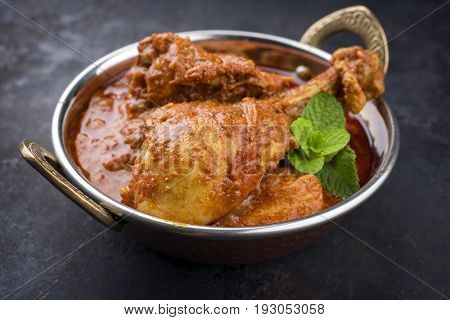 Traditional Indian Chicken Tikka Masala as close-up in a Korai