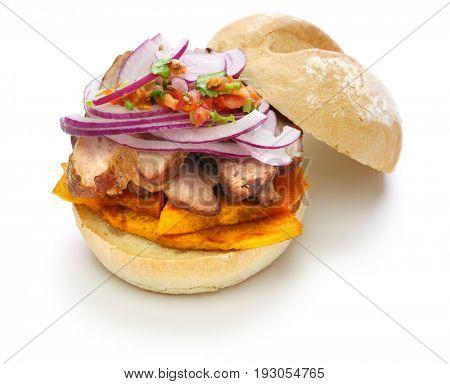 pan con chicharron, peruvian pork sandwich isolated on white background