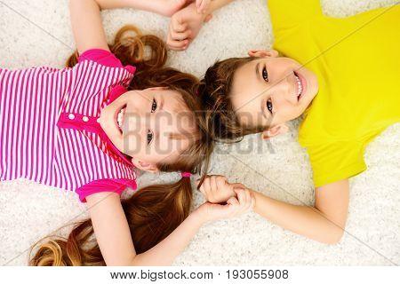Portrait of happy joyful children at home. Family concept.