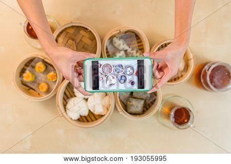Cellphone taking photo on dim sum