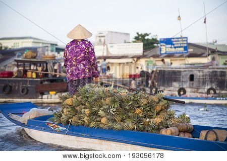 Can Tho, Vietnam - March 24, 2017 : Local people selling their goods on Cai Rang Floating Market, most famous and biggest floating market in Mekong Delta with hundreds of boats packed.