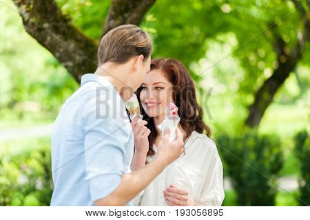 Young couple eating an ice-cream at the park