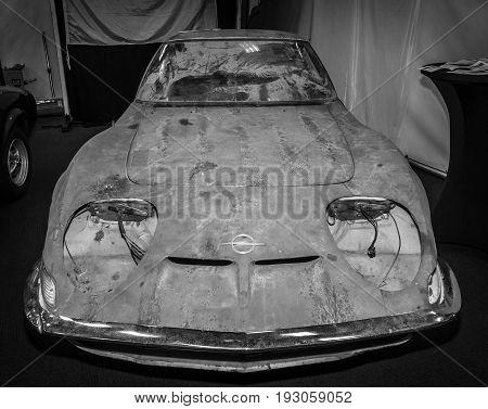 MAASTRICHT NETHERLANDS - JANUARY 15 2016: Rusty body of sports car Opel GT. Black and white. International Exhibition InterClassics & Topmobiel 2016