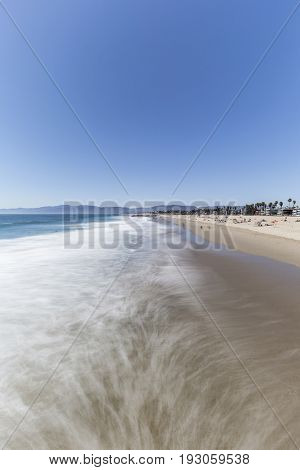 Venice Beach with motion blur surf in Los Angeles, California.