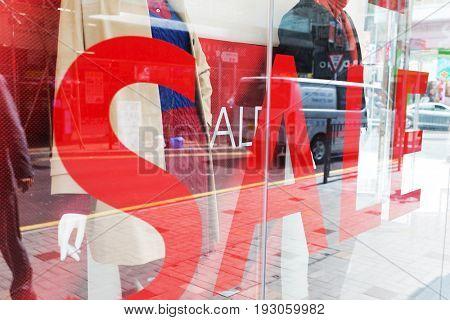 sign of sale on display window