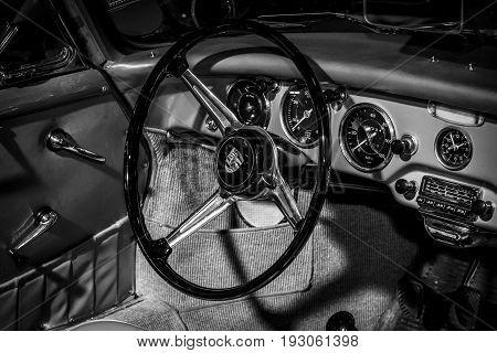 MAASTRICHT NETHERLANDS - JANUARY 15 2016: Cabin of sports car Porsche 356A Speedster 1955. Black and white. International Exhibition InterClassics & Topmobiel 2016