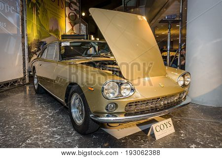 MAASTRICHT NETHERLANDS - JANUARY 15 2016: Sports car Ferrari 330 GT 2+2 Series 1 1965. International Exhibition InterClassics & Topmobiel 2016