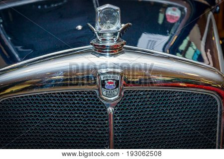 MAASTRICHT NETHERLANDS - JANUARY 15 2016: Fragment of vintage car Morris Twelve Four Pre-Series 1937. International Exhibition InterClassics & Topmobiel 2016