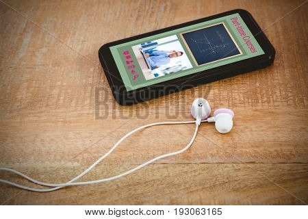 Digital composite image of e-learning interface against black smartphone with white headphones