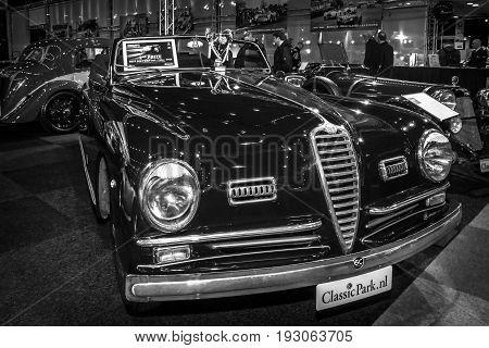 MAASTRICHT NETHERLANDS - JANUARY 15 2016: Sports car Alfa Romeo 6C 2500 SS Pinin Farina Cabriolet 1947. Black and white. International Exhibition InterClassics & Topmobiel 2016
