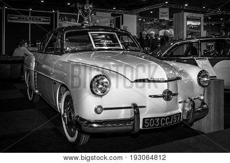 MAASTRICHT NETHERLANDS - JANUARY 15 2016: Vintage car Renault 4 cv Autobleu coupe 1956. Black and white. International Exhibition InterClassics & Topmobiel 2016