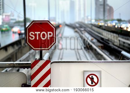 Stop Sign At Bts Taksin Station In Thailand.