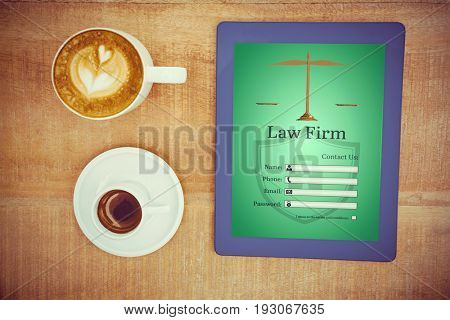 Graphic interface of lawyer contact form  against above view of coffee and a blue tablet
