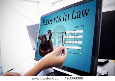 Graphic interface of lawyer contact form  against  casual businesswoman touching her computer  Casual businesswoman touching her computer with a pen