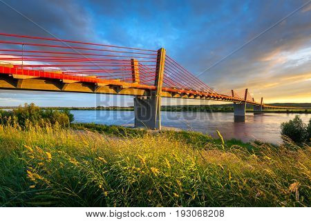 Cable stayed bridge over Vistula river in Poland at sunset