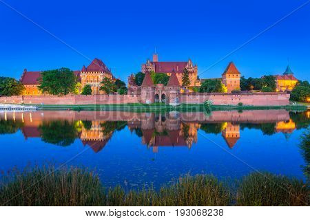 The Castle of the Teutonic Order in Malbork at night, Poland