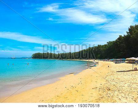 Great blue sky and calm Andaman sea on Nai Yang beach in Phuket, Thailand